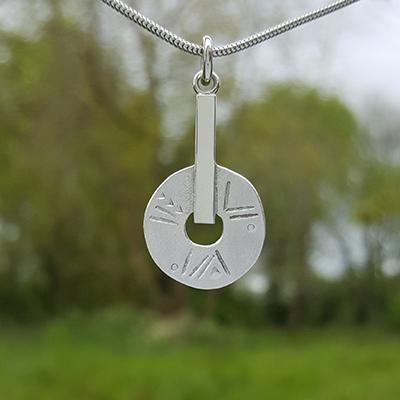 Sun Disc pendant, chased, snake chain, symbols, glyphs