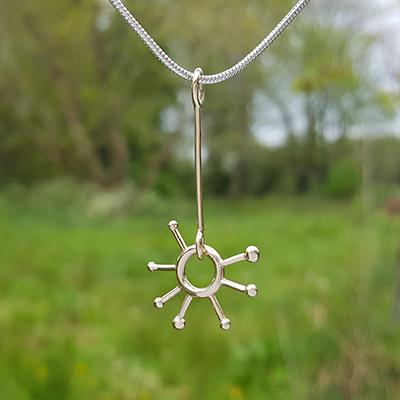 Sunburst pendant, silver snake chain